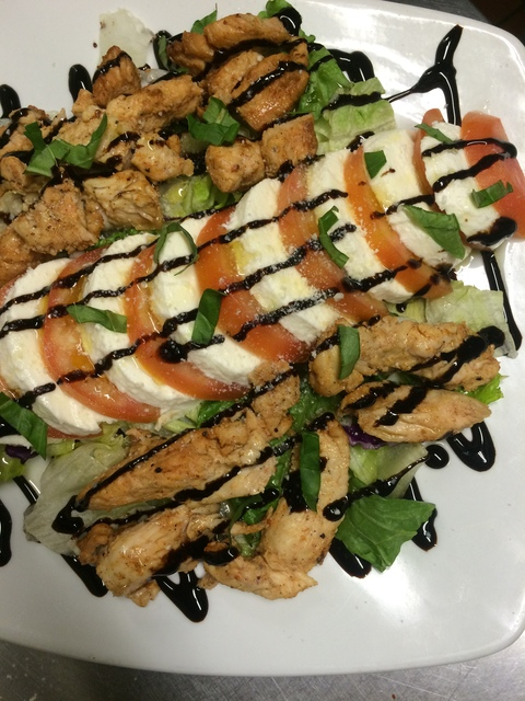 Olyvia's Chicken Caprese over a bed of lettuce
